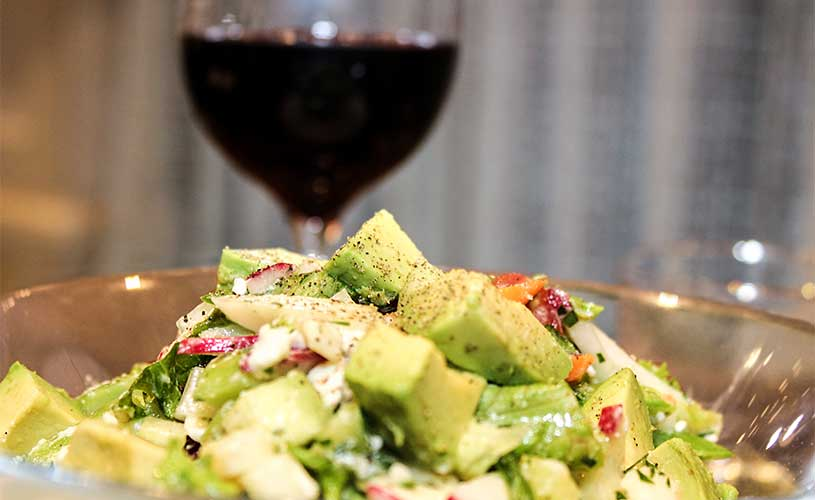 Salad with Feta and Avocado and a glass of Wine