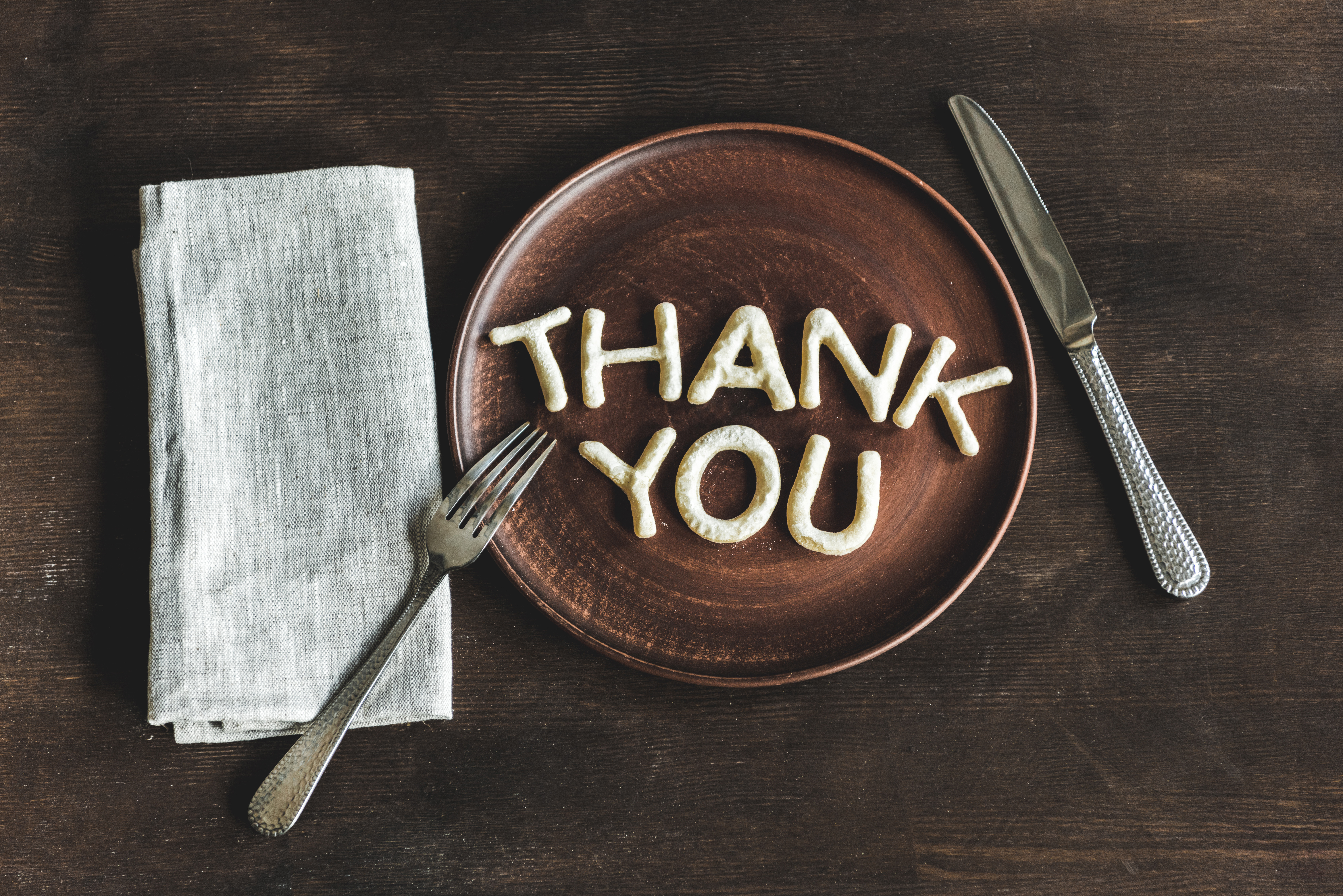 Thank you on plate with knife and fork